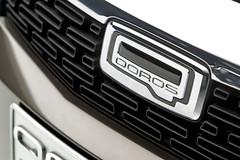 Qoros 3 Sedan - detail - front grille bonnet badge (bigblogg) Tags: sedan qoros3 qorosgq3 geneva2013