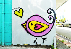 The Love Bird (Steve Taylor (Photography)) Tags: pink newzealand christchurch streetart bird art love yellow wall mall walking graffiti mural brighton heart teal tail feather canterbury madness nz southisland newbrighton