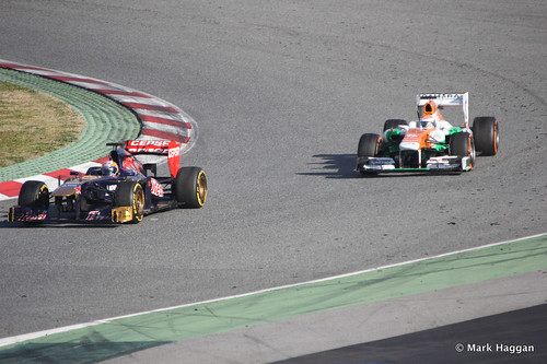 Jean-Eric Vergne in his Toro Rosso and Adrian Sutil in his Force India at Formula One Winter Testing 2013