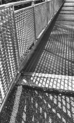 fence 025 (Harry Halibut) Tags: bw blancoynegro college sports sunshine tarmac silhouette branco fence blackwhite shadows noiretblanc thomas centre leeds angles row preto walkway repetition column grating zwart wit weiss bianco blanc nero allrightsreserved galvanised danby noire  schwatz   periodicity   angles angles contrastbysoftwarelaziness obliquamenteobliquemind 2013andrewpettigrew leeds130228025