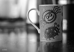 Creepy Mug! (BGDL) Tags: blackandwhite kitchen yellow monotone mug 7daysofshooting nikond7000 blackandwhitewednesday bgdl nikkor50mm118g elementsorganizer11 week38yellow