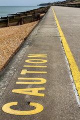Herne Bay : caution ! (Patrick Mayon) Tags: road england sign yellow landscape kent seaside line caution seafront paysage hernebay londonflickrmeetup Meetup:eventid=866222
