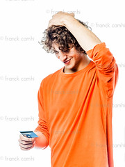 young man holding credit card portrait (Franck Camhi) Tags: portrait people hairy man money male smile smiling cutout lost happy person one cool holding adult grunge joy young handsome happiness funky indoors whitebackground thinking confused pensive casual studioshot 20 disturbed adults curlyhair confusion isolated casualwear unshaven oneperson annoyed stubble creditcard annoyance disturbance oneman finances oneyoungman