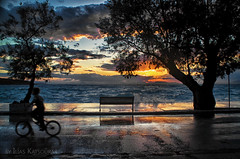 The Boy With The Bicycle (Remastered) (eliaslar) Tags: boy sunset sea sun bicycle reflections waves shadows clarity greece pelion  milina thessaly     thessalia