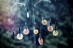 Buttons (jean_pichot1) Tags: window highlights circular focus colors wire pins hanging buttons light evening