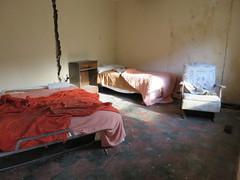 inside the Y Motel (rickele) Tags: hoquiamwashington graysharborcounty usroute101 ushighway101 ymotel outofbusiness vacant abandoned urbex roadsidemotel beds interior mold decay