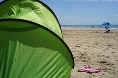 Beach Tent (Svend RS) Tags: beach color shore sea water umbrella sand tent espadrille sonyilce7 sonya7 zeiss 55mm sel55f18z sonnartfe1855 sonnar5518za 50mm seascape bokeh