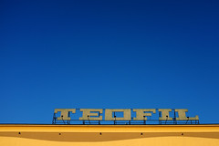 TEOFIL (RafalZych) Tags: teofil dom handlowy mall blue yellow letters lettering sign neon old stary communist lodz d teofilw poland polska fuji fujifilm x100