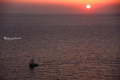 _Sunset Santorini Faro (marziabertelli) Tags: santorini sunset tramonto rosso barca sole sun faro maglifico orizzonte dritto marziabertelliph mare se sea onde wave pace summer 2016 greece greek tripdiscover