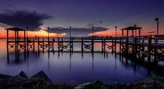 Ghosts on the Pier (fuzzy_dunlop_nola) Tags: nx500 louisiana pier samsungnx water nx samsungnx500 12mm samsungnx1224mmf456 evening view vantage mirrorless thebluehour longexposure bluehour shoreline bayou wide wideanglezoom blue southlouisiana lafitte fishing light people nx1224mmf456 rock fishingpier landscape waterscape waterfront jeanlafitte architecture sunset sunlight sky clouds cloud cloudy serene vivid colorful dusk color outdoor shore skyline rural bayoubarataria 1224mm reflection reflections jeanlafittelouisiana lafittelouisiana