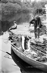 Salmon and Straw Boaters (National Library of Ireland on The Commons) Tags: ireland fish net boat fishing salmon kerry killarney spinning oar trout rods munster reels anglers glassnegative gaff creel clinker angling strawboater deerstalker salmonlake robertfrench williamlawrence nationallibraryofireland clinkerbuilt lawrencecollection trollingbait wickercreel salmontake