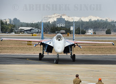 Russian Knight Arrival (illuminativisuals.com) Tags: airplane flying wings aircraft aviation jets flight jet aerobatics sukhoi flypass airdisplay su27 fighterjets formationflying aeroindia russianknights bangaloreairshow illuminativisuals abhisheksinghphotography aeroindia2013