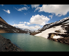 Lakeside (NomadImagesPhotography) Tags: blue terrain india mountain lake snow mountains water clouds landscape outdoors cloudy altitude indian extreme wideangle bluesky environment icy himalaya barren climate himalayas rugged harsh himalayan ladakh nationalgeographic highaltitude himachalpradesh landscapephotography lahaul canoneos50d canon1022mmlens