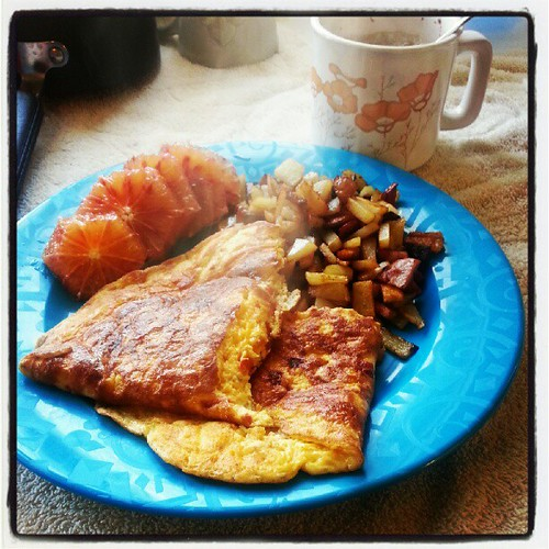 Roasted red pepper and cheese #omelette with sausage browned potatoes.