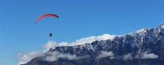 Paragliding, Queenstown , New Zealand (scinta1) Tags: queenstown newzealand southisland lakewakatipu theremarkables flight paragliding blue sky clouds clear free moutain jagged peak red canopy float