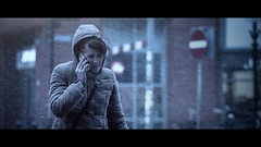 Can you please pick me up? (Jeff Krol) Tags: street winter woman snow canon movie snowflakes eos still bokeh candid streetphotography cellphone 85mm denhaag desperate hoody frame f18 flakes calling cinematic thehague 2013 ef85mmf18usm 60d canon60d img0511 jeffkrol