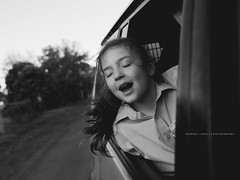 Wind in the hair (Robert Lang Photography) Tags: hair longhair car vehicle travel move movement action blackandwhite bw road dirt rural window person one stock southaustralia australia fun happy enjoyment freedom play experience life lifestyle horizontal robertlangphotography robertlang robertlangportlincoln robertlangaustralia wwwrobertlangcomau air breathe emotion face feel happiness headinghome inhale journey joy relax school sing singing transport unwind weekend wind