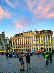 Sunset at the Grand Place in Brussels (` Toshio ') Tags: toshio brussels belgium europe european europeanunion sunset grandplace people tourists iphone clouds architecture guildhouses square