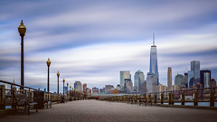 A boardwalk in the city (Eduard Moldoveanu Photography) Tags: city liberty nyc park pier usa worldtradecenter american architecture attraction bench building business center cityscape cloud color district downtown financial historic hoboken hudson jersey landmark light longexposure manhattan metropolitan midtown movingclouds new office popular river scenery sky skyline skyscraper state states station street twilight urban view world york