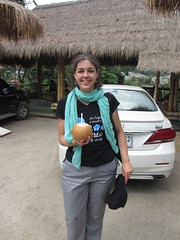 Drinking coconut milk from a coconut (eltpics) Tags: eltpics thailand nationalpark doiinthanon coconut drink coconutmilk straw scarf tshirt trousers woman grey black green description cap hat holding