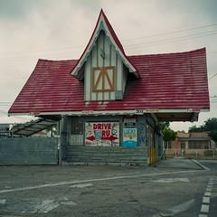 Compton red-roof Tudor drive-thru (ADMurr) Tags: la cpt store tudor red roof rolleiflex planar kodak overcast portra