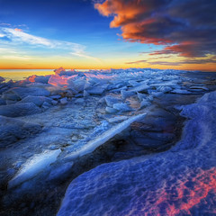 Arrival of light (Matthias Lehnecke | www.ml-foto.se) Tags: blue winter red sea orange sun lake snow seascape cold ice yellow clouds sunrise canon square sweden peaceful wideangle crop saturation 7d vnern canon1022mm mellerud lakescape icescape iceformations hjortensudde