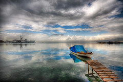 A Rainy day (Nejdet Duzen) Tags: trip travel sea cloud reflection turkey boat jetty trkiye deniz iskele sandal warship izmir bulut yansma turkei seyahat inciralt savagemisi mygearandme bestevercompetitiongroup besteverexcellencegallery