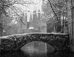 Canals (csobie) Tags: bridge winter blackandwhite bw snow architecture fairytale canon snowflakes canal belgium brugge dream medieval bruges wonderland fable 24105f4l vlaamsgewest 5dmkii