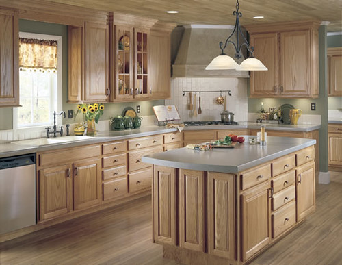 Country-kitchen-with-wooden-cabinets-and-curtains