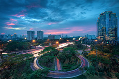 Jakarta Traffic (TheFella) Tags: city longexposure travel pink trees sunset sky urban storm slr tower skyline clouds digital skyscraper photoshop canon buildings indonesia eos lights java photo asia southeastasia cityscape skyscrapers traffic cloudy dusk muslim capital towers trails stormy jakarta photograph processing 5d lighttrails bluehour westjava dslr indonesian hdr highdynamicrange islamic urbanlandscape mkii markii traffictrails postprocessing travelphotography photomatix republicofindonesia republikindonesia thefella 5dmarkii conormacneill jakartacapitalregion thefellaphotography