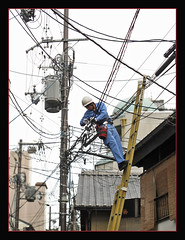 Blue is live (abriwin) Tags: japan kyoto wires pylons repairman higashiyama