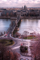 Connecting Buda & Pest - Chain Bridge (wellsie82) Tags: street city longexposure trip travel bridge winter vacation building tree heritage history tourism church water car architecture canon river photography eos rebel still movement europa europe hungary traffic basilica capital transport streetphotography tram landmark tourist unescoworldheritagesite unesco adventure commute vehicle destination commuting traveling duna exploration tramway danube hdr buda castlehill pest danuberiver zebracrossing photograhy tramline castledistrict jasonwells chainbridge centraleurope stmarysbasilica travelphotography photomatix 550d heartofeurope castlequarter budacastlequarter capitaloffreedom rememberthatmomentlevel1 wellsie82 pearlofdanube capitalofspasandthermalbaths capitaloffestivals capitalofspasthermalbaths
