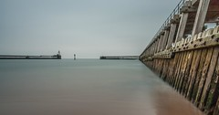 Blyth Pier (Danny Birrell) Tags: wood uk longexposure morning light sea sky lighthouse seascape beach wet water sunrise dawn coast pier minimal northumberland simple northeast blyth tamron1750f28 10stop canon40d hitech9ndgrad haidapro10stopfilter