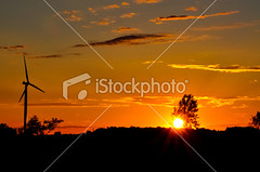Wind generator turbine at sunset (Richard-7) Tags: sunset sky cloud sun sunlight tower nature silhouette outdoors gold energy technology alternativeenergy generator electricity environment backlit choice dramaticsky propeller development cloudscape windturbine windpower renewableenergy treelined generating singleobject environmentalconservation energycreation fuelandpowergeneration multigenerationfamily latesttechnology windturbinegenerator