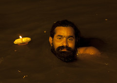 Pilgrim Bathing In Ganges, Maha Kumbh Mela, Allahabad, India (Eric Lafforgue) Tags: travel people india tourism water festival night river outdoors photography bath asia day candle religion bank event spirituality bathing hinduism pure pilgrimage religiouscelebration pilgrim oneperson frontview sangam humaninterest allahabad 2995 socialgathering haridwar purification gangesriver yamunariver uttarpradesh realpeople kumbhmela traveldestinations colorimage indianculture lookingatcamera onemanonly uttarakhand indiansubcontinent celebrationevent traditionalceremony indianethnicity candleoffering adultâ