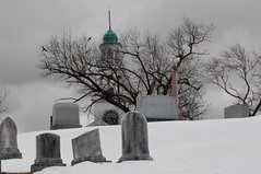 Winter Gives Up the Ghost (Bud in Wells, Maine) Tags: trees winter bw snow church monochrome cemetery reading spring massachusetts newengland gravestones laurelhillcemetery