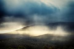 Illuminated Mount Wellington (jmangless) Tags: sunset sun mist mountains weather clouds forest radio australia wellington tasmania mast mtwellington communications