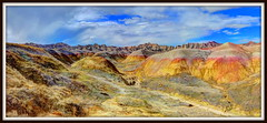 Panorama 999 (2) (mastrfshrmn) Tags: red sky panorama mountain green colors wall clouds southdakota dessert desert loop wildlife ridge valley badlands dust majestic blueyellow