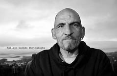 A man on a mountain (alison laredo) Tags: portrait blackandwhite bw man bald earring mayo clewbay pilgrim croaghpatrick pilgramage 2011 july31st holymountain reeksunday wwwalisonlaredocom