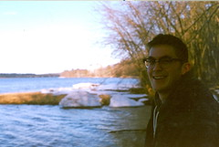 Peter Parker (Swintonator) Tags: male film wet smile forest river walking happy glasses hoodie snowy exploring peterparker x fredericton adventure newbrunswick icy muddy quirky nerdy eastcoast foureyes shading stjohnriver