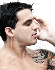 Profile (Rebeca Mello) Tags: brazil portrait man wet water beauty up gua closeup brasil tattoo photoshop canon studio shower drops model bath close retrato profile modelo gotas homem youngman banho darkhair pingos drippingwater cs5 eos50d canoneos50d beautymale pingosdegua rebecamello rebecamcmello tattooedshoulder closeupofprofilemanonshower closeupmanonshower closeupofprofileyoungmanonshower