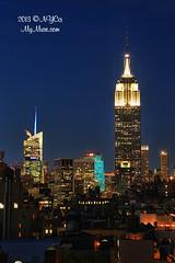 Empire State Building in White, 30 Rock lit up Tiffany Blue (NYCisMyMuse) Tags: nyc newyorkcity sunset newyork skyline architecture night cityscape skyscrapers dusk manhattan citylights manhattanskyline bluehour tiffany 30rock tiffanyblue bankofamericatower 30rockefellercenter onebryantpark