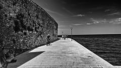 Pore Nieuwe Promenade / Pore New Promenade (jo.misere) Tags: pore istri kroati bw zw promenade water zee fiets people bicycle wall muur ngc