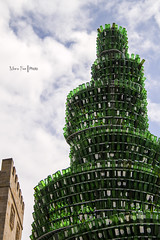 Sidra (Moira_Fee) Tags: sidra gijon xixon asturias asturies espaa sidrina monumento botellas bottles cristal verde green chrystal tower cielo sky blue azul nubes clouds paisaje moira fee landscape