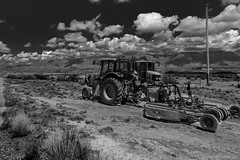 Exploring New Mexico (Barb McCourt) Tags: desert desertlandscape desertvegetation desertphotography mountainsinbackground clouds heavyequipment blackandwhitephotography blackandwhite bnw bw sonyrx100m4