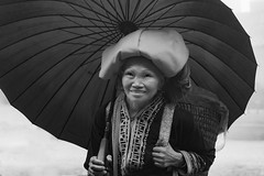 Rainy day portrait (tmeallen) Tags: oldwoman ethnicminority traditionalattire reddao redyao umbrella rainyday smiling sapa vietnam borderregions culture
