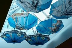 Cafe (tayveionwallace) Tags: eiffeltower cafe blue clouds rain umbrella street colors wideangle france london paris sky melrose f28 a6000 sony losangeles california unitedstates