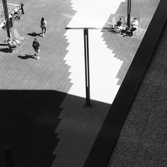 The path to knowledge (halifaxlight) Tags: canada novascotia halifax centrallibrary entrance path lights figures sitting walking sunny shadows lookingdown above bw square