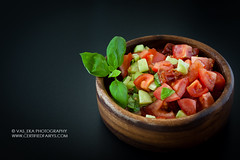 Tomato salad with cucumbers, decorated with basil leafs (vas_eka) Tags: cleaneating cooking culinary detox diet fitfood fitness food foodphoto healthy menu motivation nutrition paleo rawvegan restaurant styling vegan vegetarian tomato salad basil isolated black