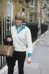 83926d (mraqcarvalho) Tags: princess diana when she was lady spencer working a nursery britain 1980 walking along street handbag scarf neckerchief white cardigan top blue blouse pearl necklace fashion transport royalty alone personality 2585957